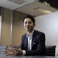 Masami Takahashi, president of Japan at Uber Technologies Inc., speaks during an interview in Tokyo on Sept. 13. Uber is finding modest success in the small coastal town of Tangocho, once known for supplying fabric to kimono tailors in the ancient capital of Kyoto, a three-hour bus ride away. | BLOOMBERG