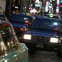 Uber Technologies Inc.'s ride-sharing business faces protests from Japan's taxi associations. | BLOOMBERG