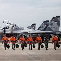 Indonesian Air Force Sukhoi fighter pilots and crew walk across the tarmac after training for an upcoming military exercise at Hang Nadim Airport, Batam, Riau Islands, Indonesia, on Monday. | ANTARA FOTO / VIA REUTERS