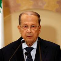 Michel Aoun talks during a news conference in Beirut on Oct. 20. | REUTERS