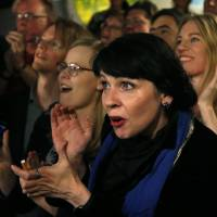 Birgitta Jonsdottir of the Pirate party reacts after the first results in Reykjavik on Saturday. | AP