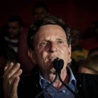 Evangelical's election as Rio mayor points to shift rightward in Brazil