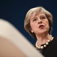 Britain's Prime Minister Theresa May delivers a speech on the first day of the Conservative Party annual conference at the International Convention Centre in Birmingham, England, on Sunday. | AFP-JIJI