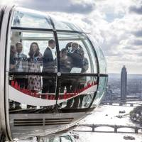 Britain's Princes William and Harry, and Kate, The Duchess of Cambridge, take a ride in a pod of the London Eye with members of the mental health charity Heads together on world mental health day in London Monday. | REUTERS