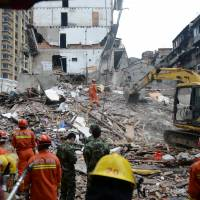 At least 20 reported killed as migrant-packed buildings in China collapse