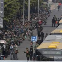 Rare protest by ex-soldiers at China's Defense Ministry prompts heightened security