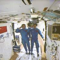 Chinese astronauts reach and enter space station