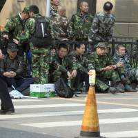 China veterans' protests for better pensions regarded as a test for nation's leaders