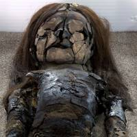 A mummified Chinchorro baby lies inside Azapa's San Miguel Museum in Arica, Chile. | REUTERS