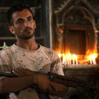 Near Mosul, Iraqi Christians pray again in charred church once occupied by IS