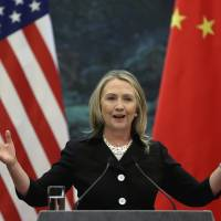 U.S. Secretary of State Hillary Clinton speaks at a news conference at Beijing's Great Hall of the People in September 2012. | AP
