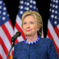 Democratic U.S. presidential nominee Hillary Clinton holds an unscheduled news conference to talk about FBI inquiries into her emails after a campaign rally in Des Moines, Iowa, on Friday. | REUTERS