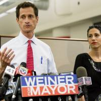 Then-New York mayoral candidate Anthony Weiner speaks during a news conference alongside his wife, Huma Abedin, in New York in July 2013. | AP