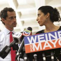 Anthony Weiner, then candidate for New York mayor, attends a news conference with his wife, Huma Abedin, in New York in July 2013. | REUTERS