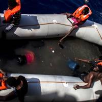 29 corpses found in crowded dinghy's pool of fuel, seawater off Libya as 2016 record death toll mounts