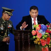 In China overture, Duterte declares military, economic separation from U.S.