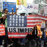 Filipinos protest joint military exercises outside the U.S. Embassy in Manila on Tuesday. | REUTERS