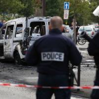 French police officer fighting for his life after gang of youths torches his cruiser