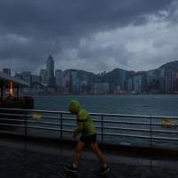 Hong Kong hunkers down as Typhoon Haima looms