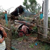 Typhoon kills at least four in Philippines