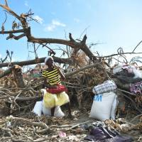Hurricane-hit Haiti tries to rebuild amid cholera outbreak