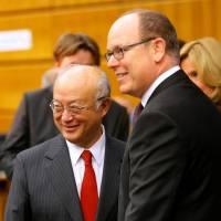 IAEA Director General Yukiya Amano (left) and Prince Albert II of Monaco arrive at a sideline event of the IAEA general conference in Vienna on Wednesday. | REUTERS