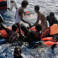 1,800 more migrants plucked from crowded boats off Libya; 23 bodies found