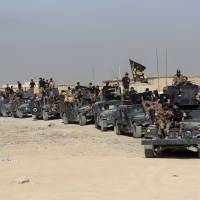 Iraqi forces launch military push to drive Islamic State group from Mosul