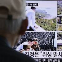 A man watches TV news showing images from an apparent ground test of a high-powered rocket engine and North Korean leader Kim Jong Un, in Seoul on Sept. 20. | AP
