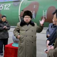 North Korean leader Kim Jong Un meets scientists and technicians in the field of research into nuclear weapons in this undated photo released in March. | KCNA / VIA REUTERS