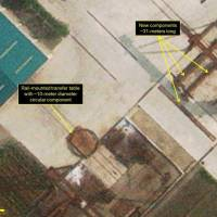 A satellite image taken Sept. 24 shows new components in the storage yard of North Korea's main Sinpo South Shipyard. Experts believe they could be intended for a new submarine. | GETTY VIA / KYODO