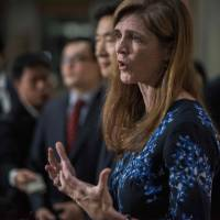 U.S. Ambassador to the U.N. Samantha Power holds a 'doorstep' session with the media following her meeting with South Korea's foreign minister, Yun Byung-se, at the foreign ministry in Seoul on Monday. | AFP-JIJI
