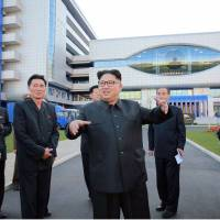 This undated picture released by North Korea's official Korean Central News Agency (KCNA) on Tuesday shows North Korean leader Kim Jong-Un inspecting the newly built Ryugyong General Ophthalmic Hospital in Pyongyang. | KCNA / AFP-JIJI