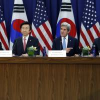 U.S. vows 'overwhelming' response if Pyongyang uses nukes, readies THAAD deployment
