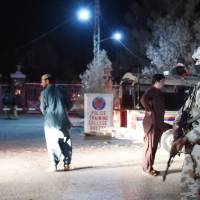 Gunmen wound 14 at Pakistan police training center hours after attackers kill two customs officers