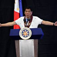 Philippine President Rodrigo Duterte speaks during a meeting with banana production businessmen in Davao city, in the southern Philippines, on Friday. | REUTERS
