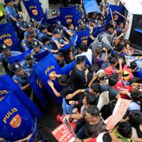 Police van rams protesters in front of U.S. Embassy in Manila