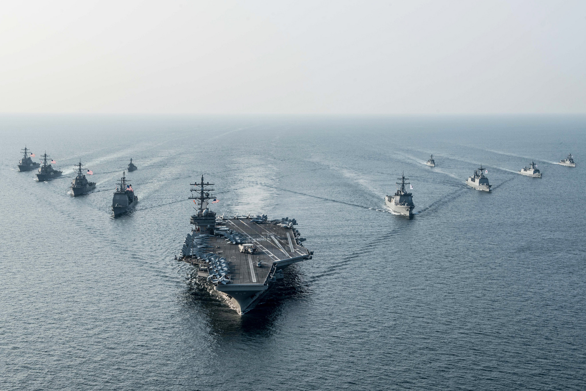 The Yokosuka, Kanagawa Prefecture-based USS Ronald Reagan steams in formation with ships from the U.S. Navy's Carrier Strike Group Five and the Republic of Korea's Navy during the Invincible Spirit drills in waters off the Korean Peninsula on Friday. | U.S. NAVY