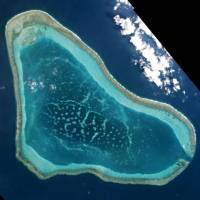 Scarborough Shoal in the South China Sea is seen in this photo taken in March. | PLANET LABS / VIA REUTERS