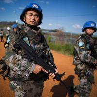Chinese troops with the United Nations Mission in South Sudan (UNMISS) patrol outside the premises of the U.N. Protection of Civilians site in Juba on Oct. 4. | AFP-JIJI