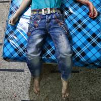 The body of a child is seen at a makeshift hospital following a reported cluster bomb attack on the rebel-held town of Douma, east of the Syrian capital of Damascus, on Monday. | AFP-JIJI