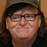 U.S. filmmaker Michael Moore attends a June photo call for his new film 'Where To Invade Next' in London. In 2004, Moore took on George W. Bush in 'Fahrenheit 9/11.' On Tuesday, the filmmaker surprised his fans with news that he would debut his new film about Donald Trump.   AFP-JIJI