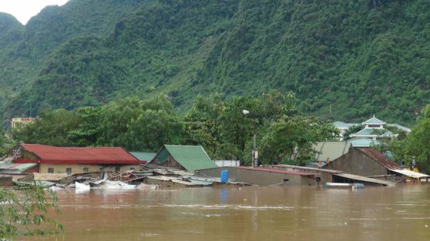 Floods kill 24 in central Vietnam as Typhoon Sarika approaches nation