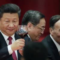Chinese President Xi Jinping makes a toast to high-ranking officials at a dinner marking the 67th anniversary of the founding of the People's Republic of China at the Great Hall of the People in Beijing on Friday. China's National Day is celebrated on Oct. 1. | AP