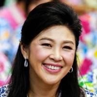 Former Thai Prime Minister Yingluck Shinawatra takes part in Songkran festival celebrations with opposition Puea Thai party members at the party's headquarters in Bangkok in April 2016. | REUTERS