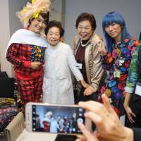 Model Miyo Maki (second from left) poses with supporters prior to the tenbo 2017 spring/summer collection show at Amazon Fashion Week Tokyo on Wednesday. | AFP-JIJI