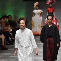 Miyo Maki displays a creation by designer Takafumi Tsuruta at Amazon Fashion Week Tokyo on Wednesday. | AFP-JIJI