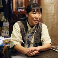 Photographer helping to hand down Ainu culture with new photo book