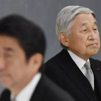 Emperor Akihito and Prime Minister Shinzo Abe attend a government-sponsored event marking the end of World War II on Aug. 15 in Tokyo. | KYODO