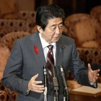 Abe urges Renho to prove her status under the law with release of family registry